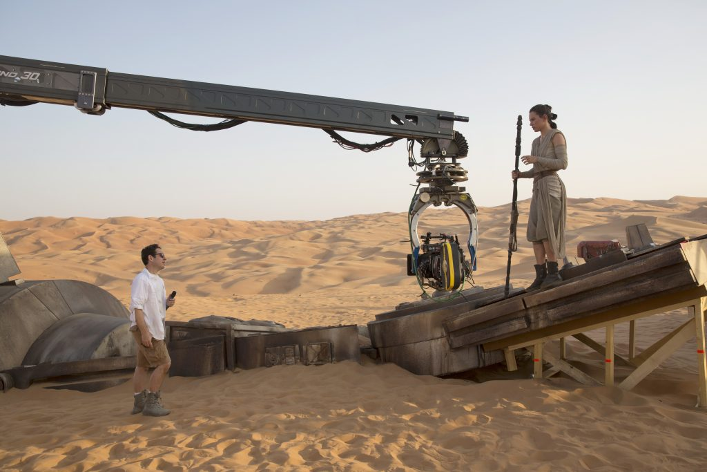 Star Wars: The Force Awakens..L to R: Director J.J. Abrams w/ actress Daisy Ridley (Rey) on set...Ph: David James..? 2015 Lucasfilm Ltd. & TM. All Right Reserved.