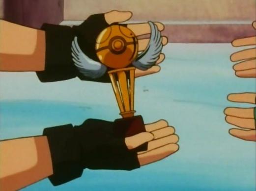 Drake entrega o troféu de campeão da Liga Laranja para Ash Ketchum
